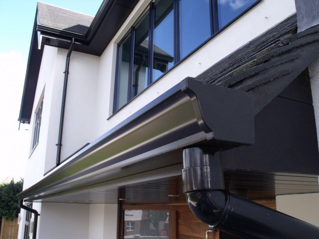 Close up of seamless aluminium gutter and pvc drain pipe home close up of seamless aluminium gutter and pvc drain pipe solutioingenieria Images