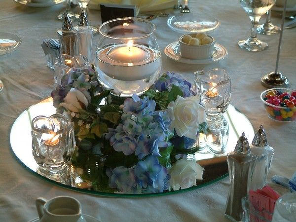 Hydrangea mirror and candles centerpiece wedding day