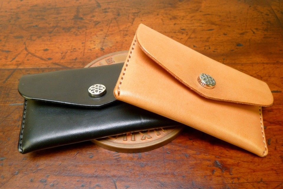 Leather business card / credit card holder w/ sterling Rosette snap.  Hand sewn, American made. The leather feels good and gets better with age!