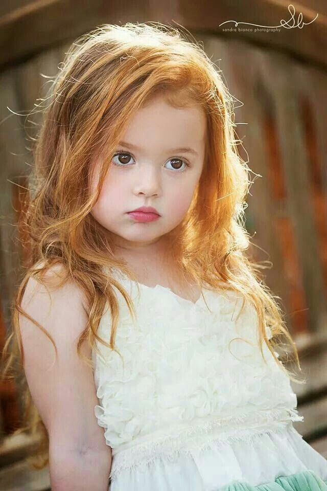 I love brown eyes with red hair -- so pretty.and this little one knows it!