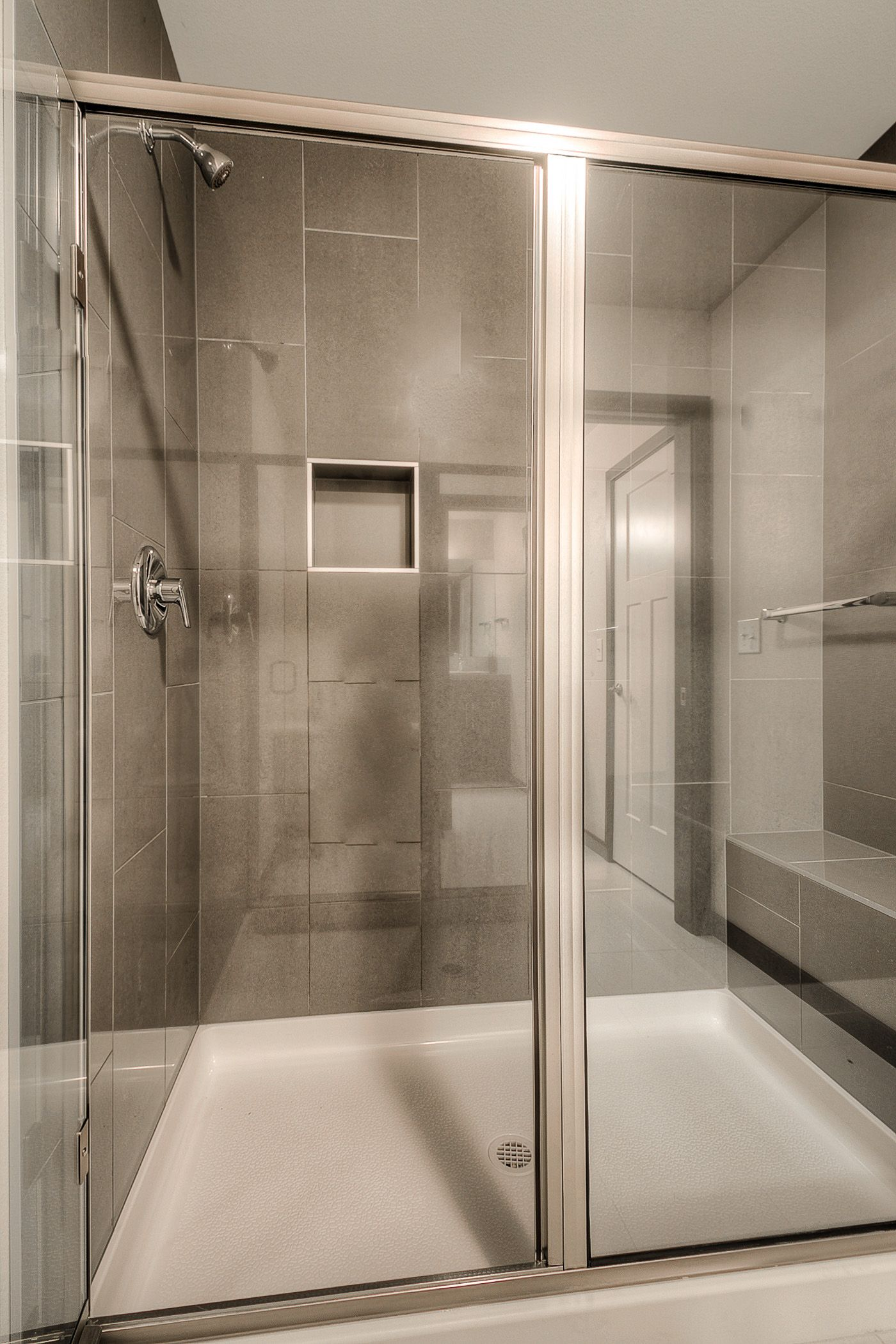 Gorgeous full sized walk in shower with bench
