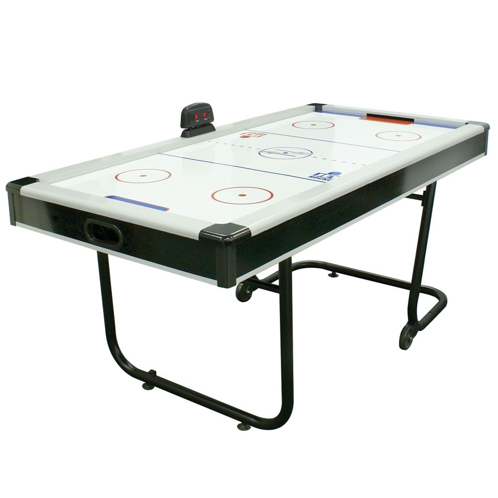 The Space Saving Air Hockey Table Hammacher Schlemmer Air Hockey Table Air Hockey Game Room