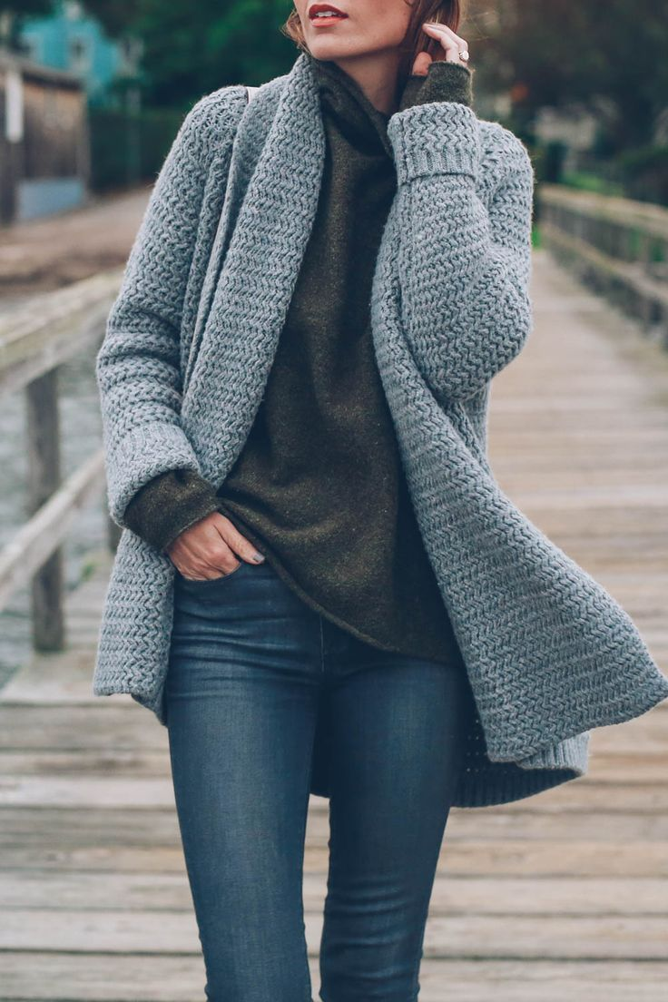 Sweater layering by Jess Ann Kirby wearing a funnel neck sweater and chunky knit cardigan