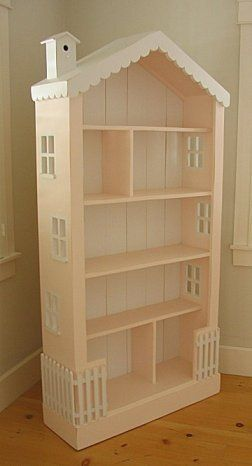 Old bookcase turned dollhouse.