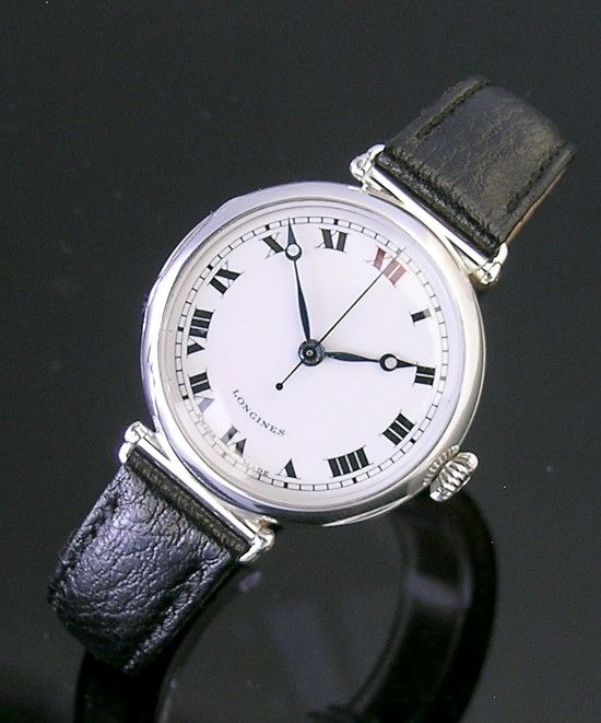 A round silver vintage Longines watch, 1935