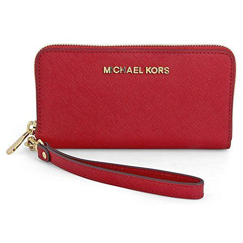 "Michael Kors Jet Set Travel Wallet Chili Red. Classy & durable Saffiano leather with matching leather trim. Measures approx. 6.75 inch x 4 inch x 1 inch; detachable wrist strap. Zip around closure; three compartment with five credit card slots and ID window. Compartment for cell phone (up to 5.5"" x 3"" x 0.25""); zip coin pocket. ~Guaranteed Authentic Michael Kors~."