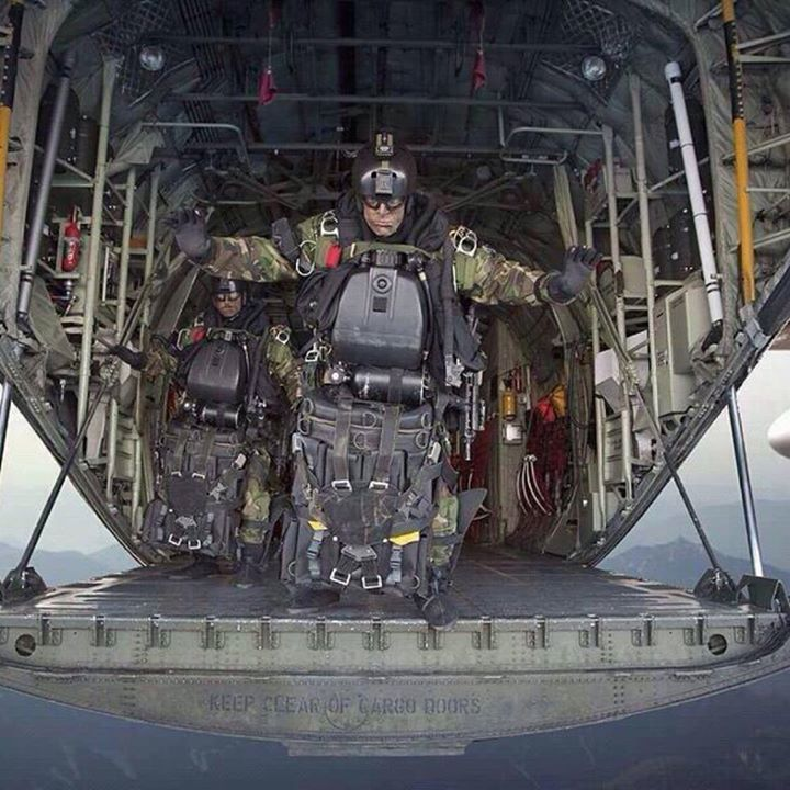 U.S. Navy SEALs moments before a High Altitude Low Opening (HALO) jump.