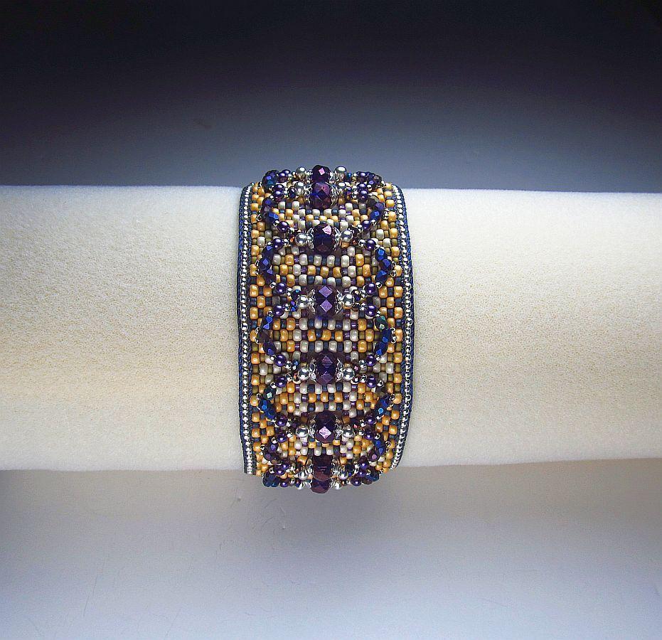"www.beadsbeadingbeaded.com ""Tweed"", loom woven cuff, in green/gold/off white/purple."