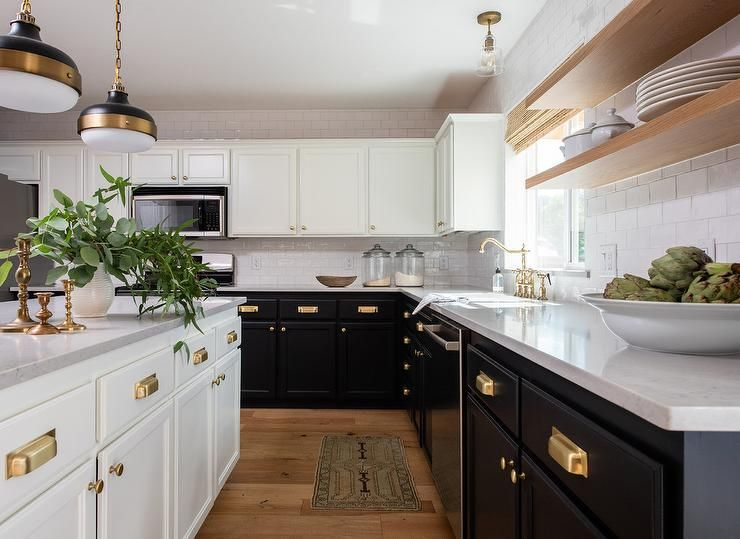 Large black and white kitchen boasting brushed gold cup ...