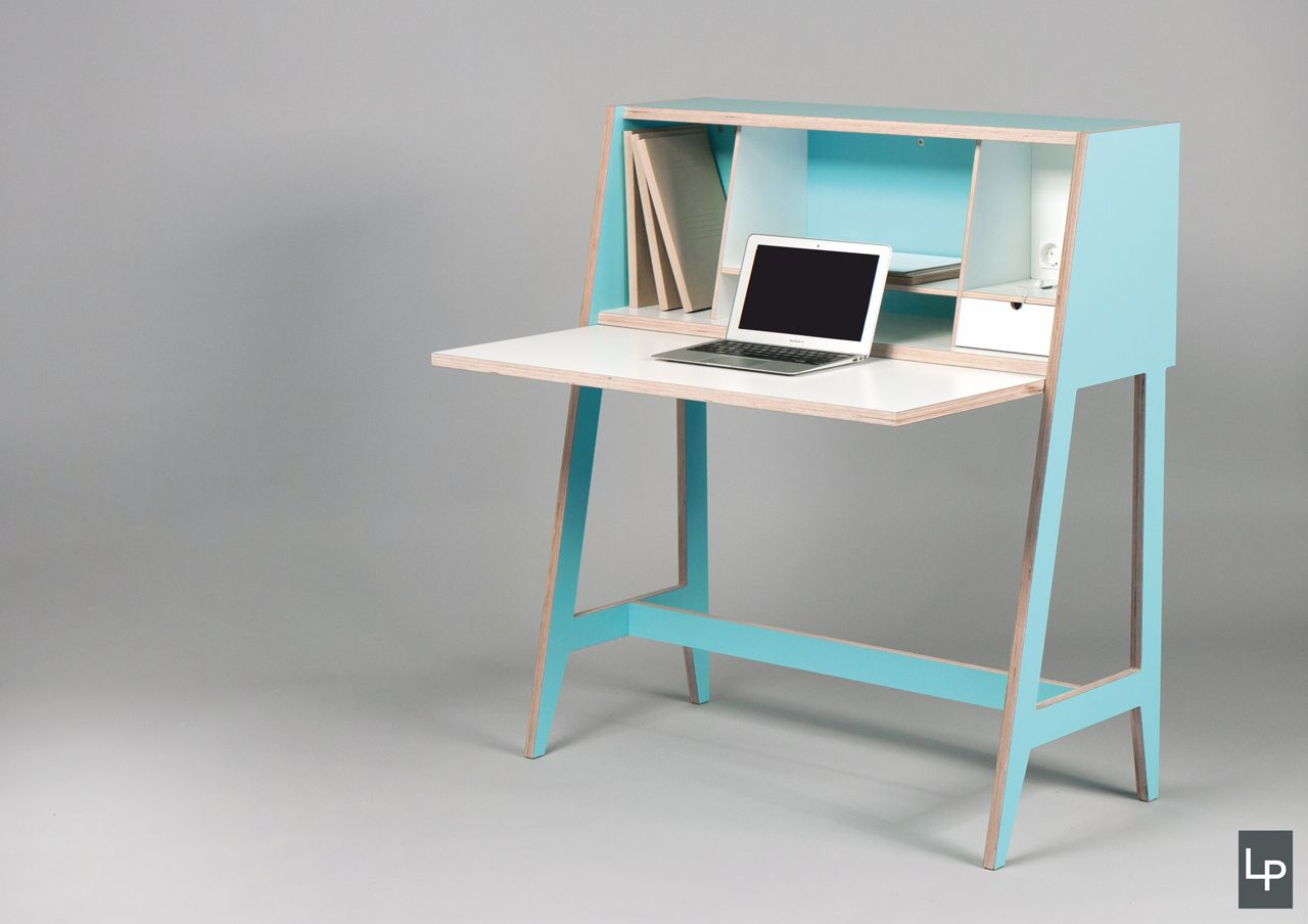 A fully-functioning workspace hidden within a cabinet