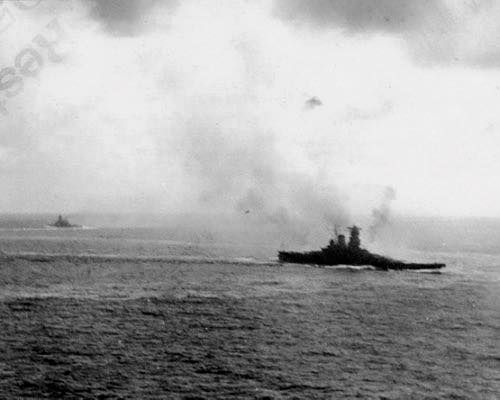 Photo taken by a US aircraft during the battle of the Philippine sea, June 1944. A Yamato class battleship is in the foreground while the battleship Haruna is steaming in the opposite direction, evading American torpedoes.