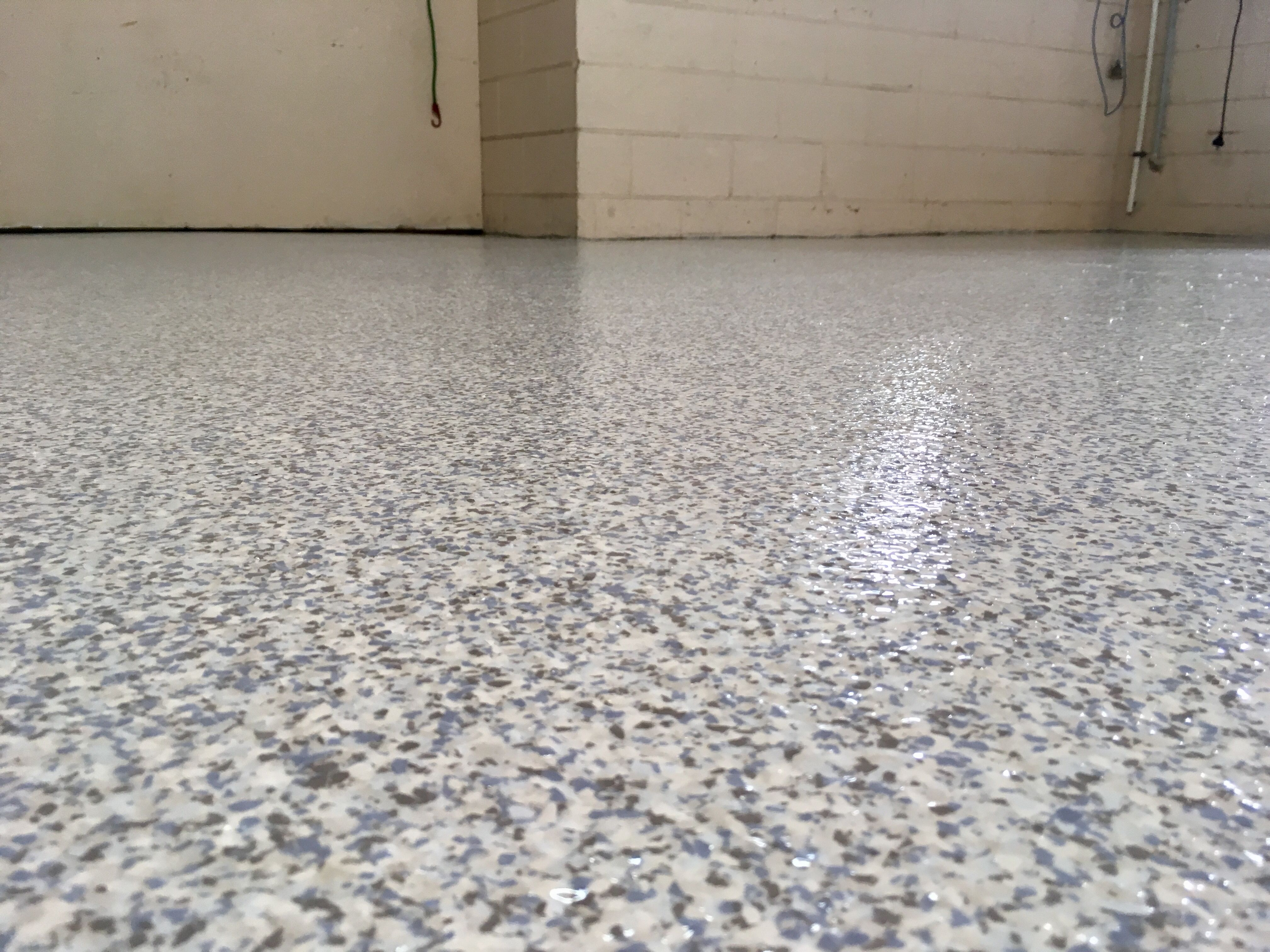 Frozen Epoxy Flake Over A White Base Coat By The Garage Floor Co Looks Amazing On Any Concrete Floor Garage Floor Flooring Concrete Floors