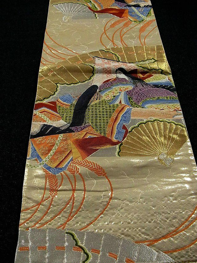 this is a luxurious gold fukuro obi with pattern of noble people