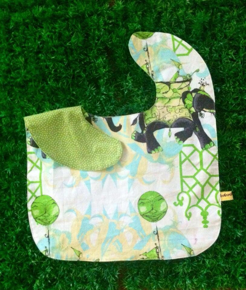 Oversized No Mess Reversible Bib in Elephant Run / Pindots. Wear it on your tot during feeding time. The oversized bib protects your child's clothing... No need to worry about spills, stains and mess! Best especially for moms who are scared of getting their child's clothes dirty! =)  Send us a message at info@ilovebabinski.com & LIKE us on Facebook  Php 120.00 www.ilovebabinski.com