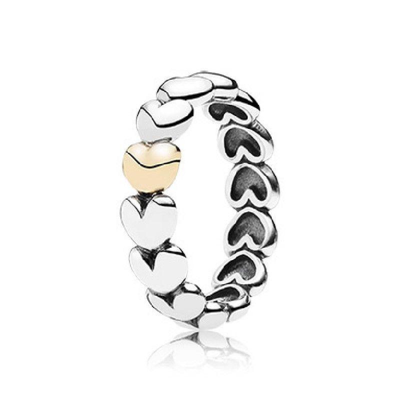 anillo pandora corazones oro