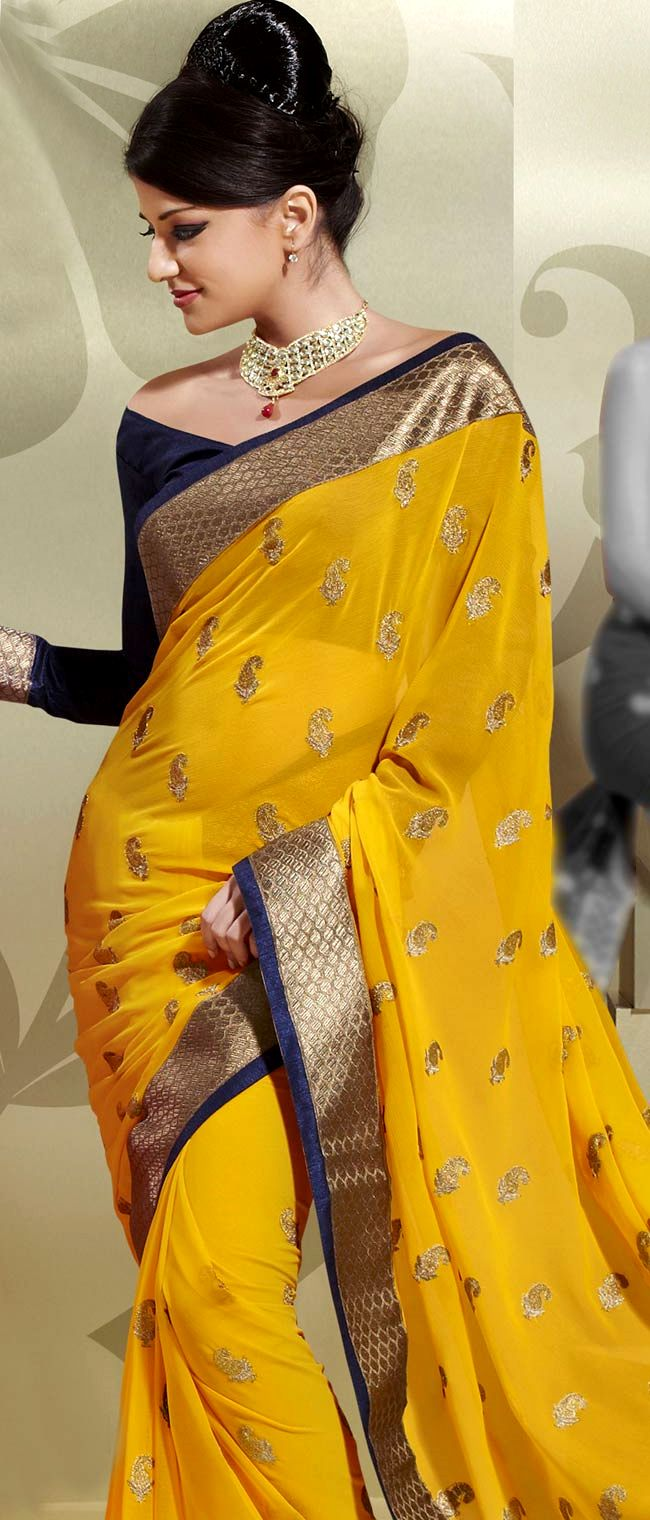 Yellow and Navy Blue Faux Georgette Saree with Blouse    Itemcode: SSL1654B    Price: US $59.40    Click here to shop: http://www.utsavfashion.com/store/sarees-large.aspx?icode=SSL1654B