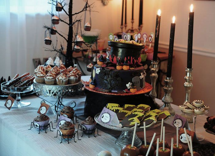 charming halloween table decor with black candles and cool deserts - Halloween Table Decor