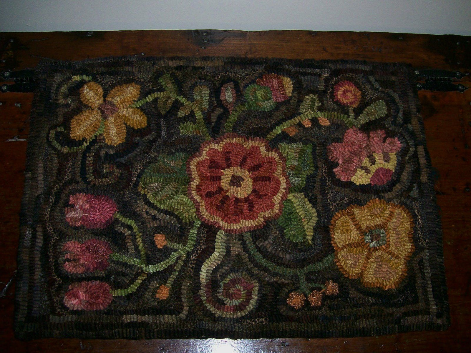 A Primitive Floral I hooked a couple of years ago. Hooked on Primitives.  http://hookedonprimitives.blogspot.com/