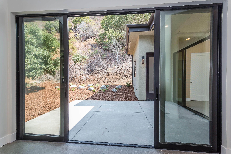 Western Sliding Doors That Open Onto Concrete Patiio Windows And Doors Modern Sliding Doors