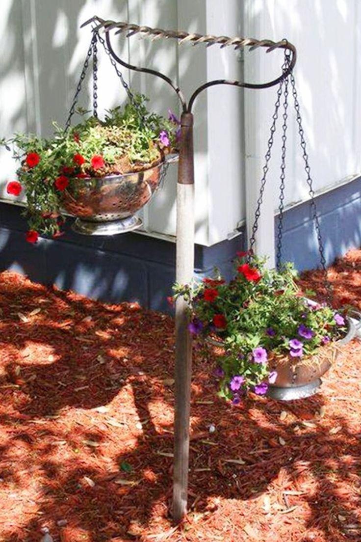 Easy DIY gardening ideas - repurposed rake turned into a hanging flower basket holder for your flower garden or backyard