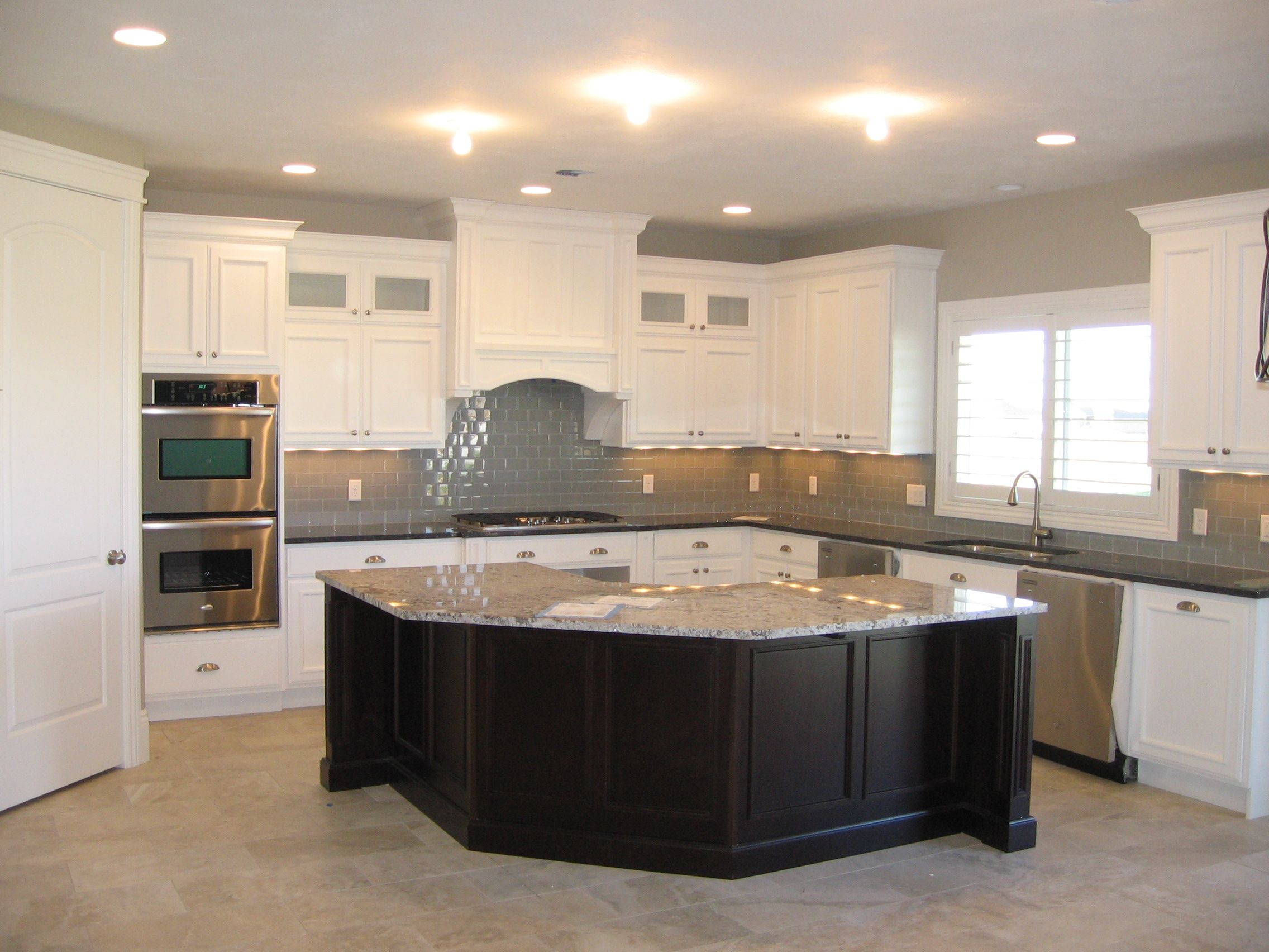 Grey Subway Tile White Cabinets And Dark Island Symphonyhomes