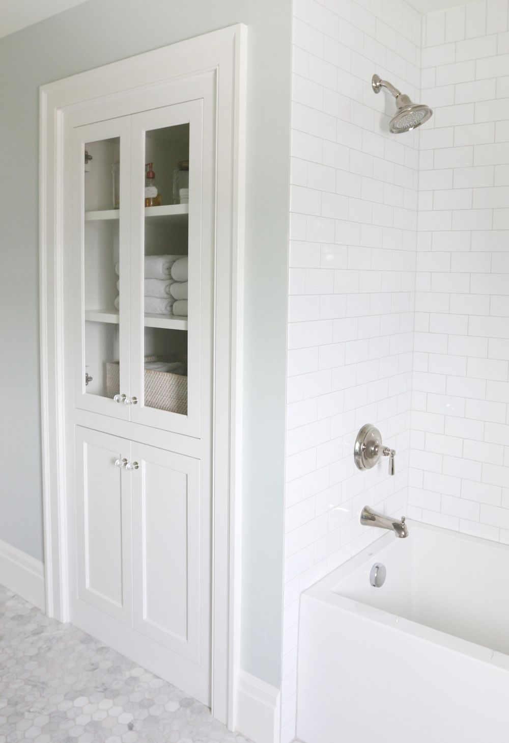 Gray and white marble subway tile on shower wall and baseboard - Subway Tile Shower With Gray Grout Studio Mcgee