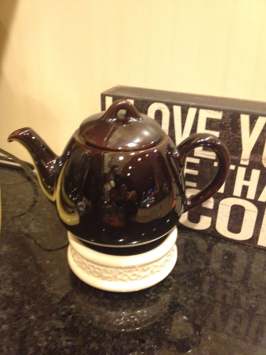 My vintage teapot my mom had. I set in a scented tea light and place the pot on a candle warmer. Fills the air with yummy scent.