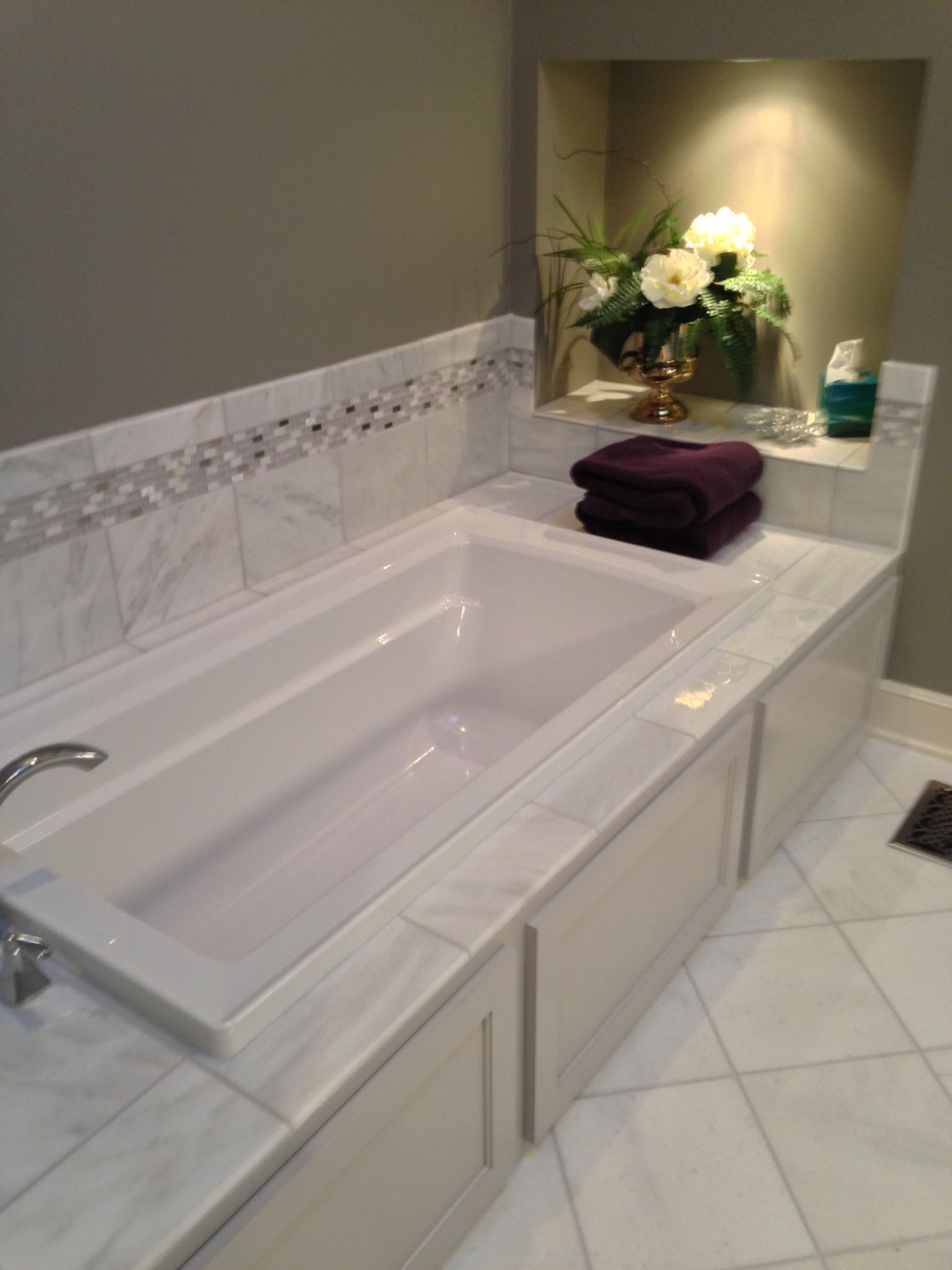 Drop In Jacuzzi Bath Tub With Tile Backsplash And Cabinet Space