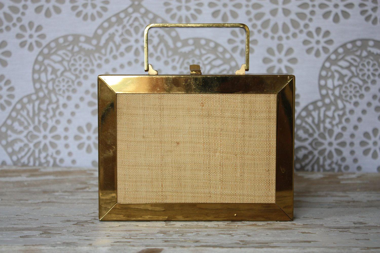 Vintage 1950's Gold Tone Metal Box Purse with Raffia Accents. $52.50, via Etsy.