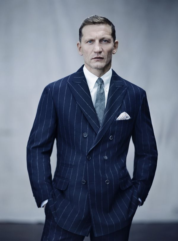 Double-breasted peak-lapel sport coat in navy pinstripe wool