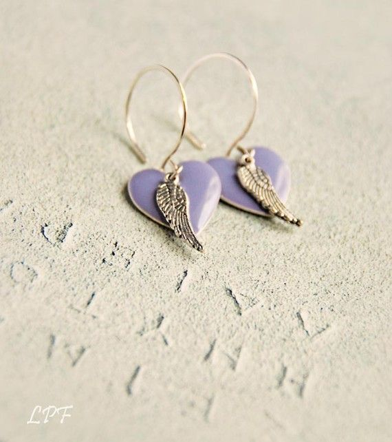 Add a touch of magic and romance in your everyday with these adorable earrings.  Beautiful purple enameled hearts are paired with tiny detailed