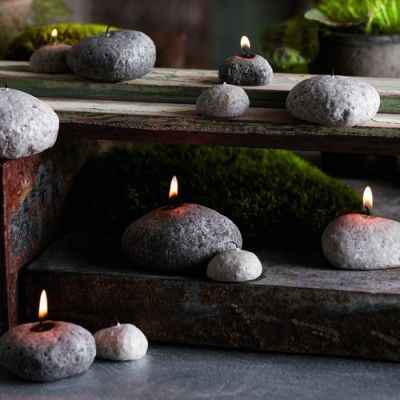 *Holes drilled into stones to make candle holders - Neat Idea!