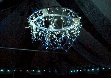 Hoola hoop Chandelier for outdoor reception. Two Hula hoops White duct tape White Icicle electrical lights Blue battery operated lights