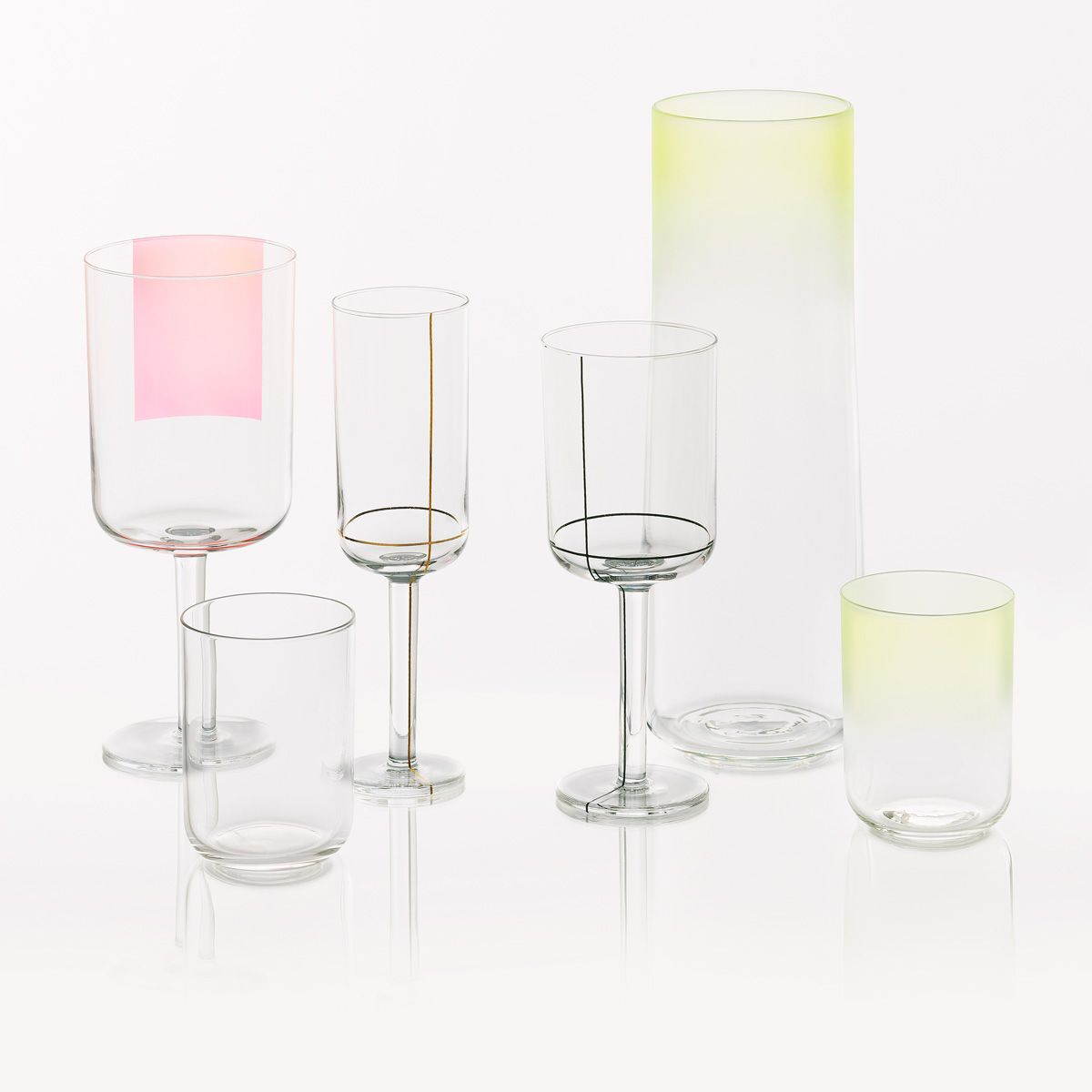 Hay Colour Glass  The Colour Glass collection is a range of minimalist glassware by Scholten & Baijings. It includes high and low water glasses, a red wine glass, a white wine glass, a champagne glass and a carafe. The glasses and carafe come in in three different designs: with yellow or blue fading from the top, or a golden dot at the bottom of the vessels. The red wine glass comes with a pink square on one side, the white wine glass has black grid lines and the c