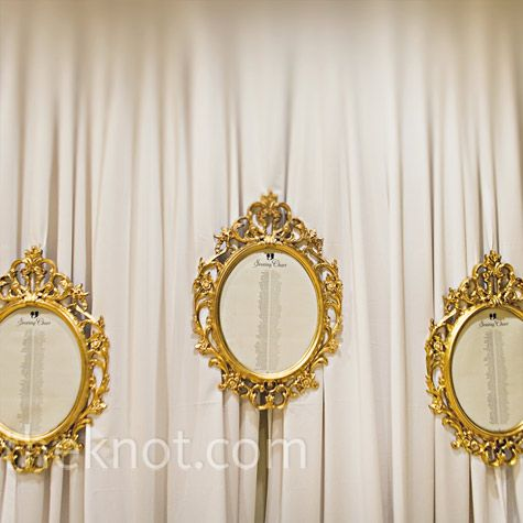 Suspended gold frames held the seating charts which were accented with the couple's signature silhouette design.