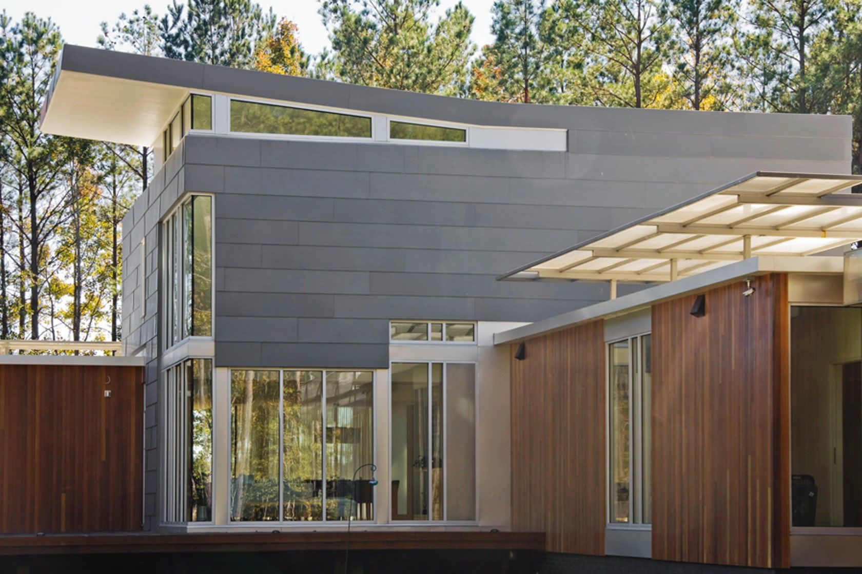Vmzinc S Flat Lock Panel Is A Wall Cladding System That Uses Overlapped Metal Panels So That A Nearly Flat A Metal Cladding Metal Siding Cost Building Cladding