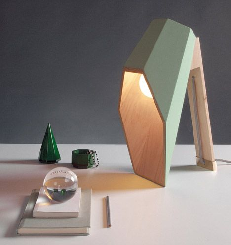 Lamp designed with a hexagonal wooden shade that extends over its – Desk Lamp Light Bulb