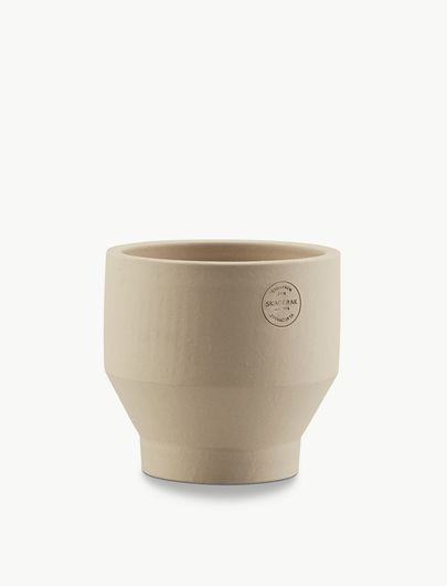 Skagerak Terracotta Edge Pot Small: Simple and stylish terracotta pot with an embossed stamp. Includes metal stand inside pot for drainage. By Skagerak.