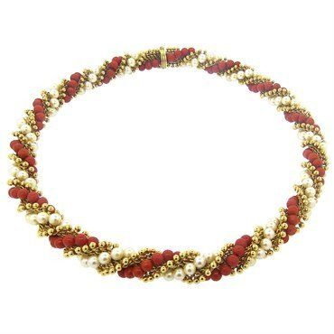 An 18k yellow gold necklace set with 5mm saltwater cultured pearls and 5mm coral…