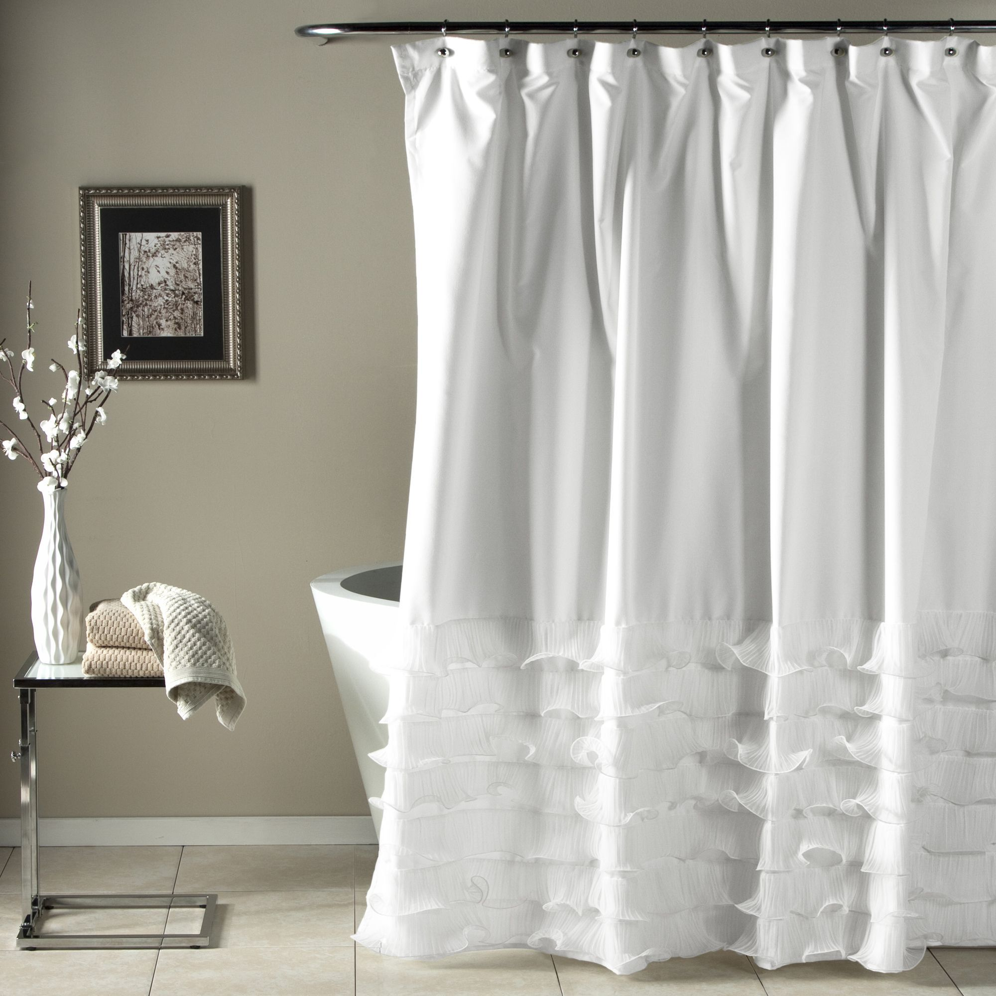 The avery shower curtain features ripples of diaphanous tiers over a