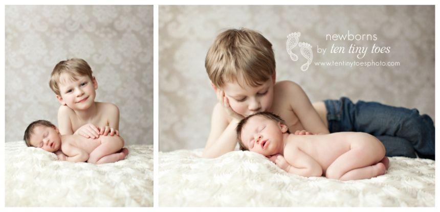 Big brother with newborn baby sister