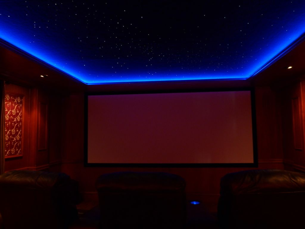 Use rope lights behind slightly lowered molding for movie lighting. A  friend has a projector