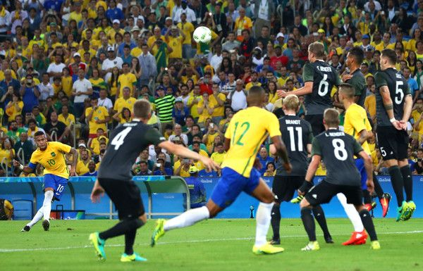 Neymar Photos Photos - Neymar of Brazil scores the first Brazil goal during the Men's Football Final between Brazil and Germany at the Maracana Stadium on Day 15 of the Rio 2016 Olympic Games on August 20, 2016 in Rio de Janeiro, Brazil. - Brazil v Germany - Final: Men's Football - Olympics: Day 15