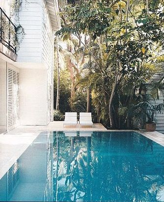 Collette Dinnigan's house exterior,floor to ceiling glass in the living areas overlooking the pool.
