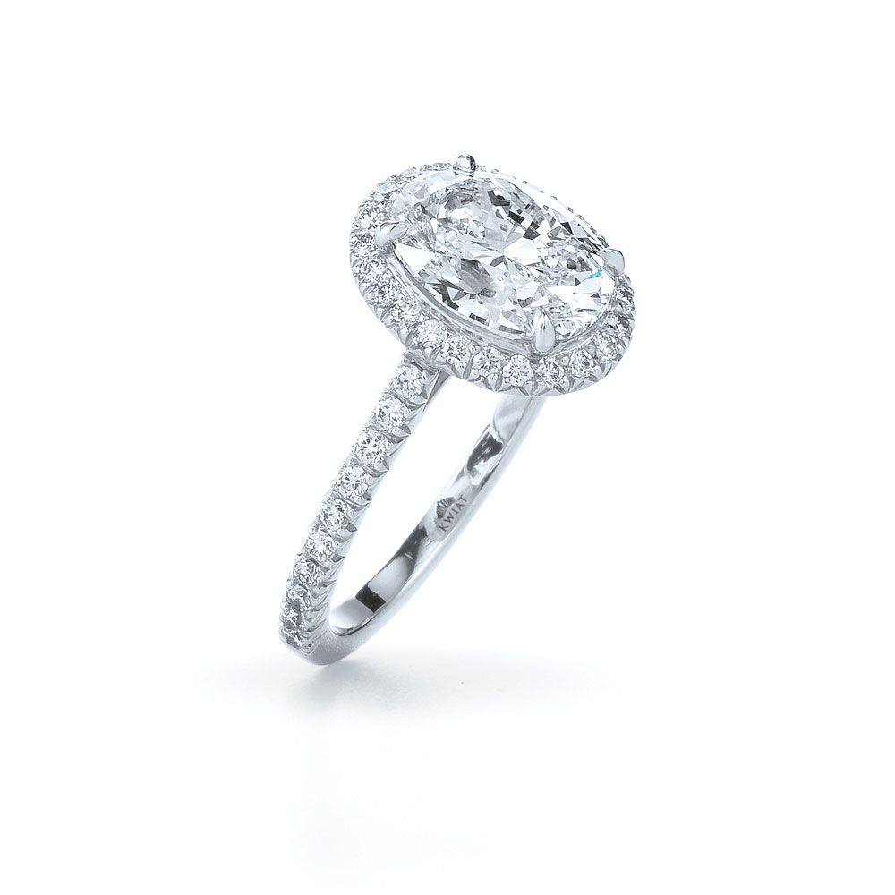 Oval diamond ring with a diamond frame a pave diamond ring in