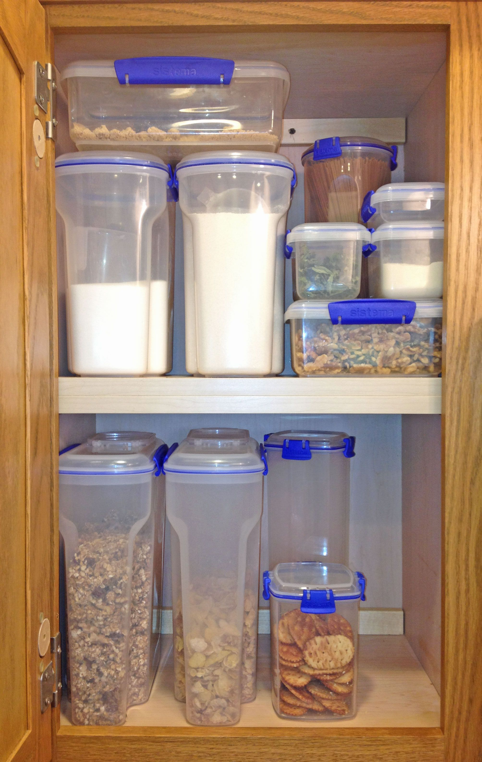 Kitchen Food Storage Sistema Klip It Food Storage Containers Displayed In A Cabinet