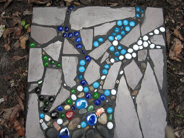 I like the idea of caulking glass beads to the sides of a cinderblock raised garden bed...