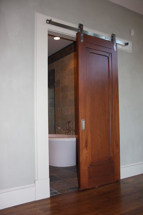 ... Reused old barn door creates a fabulous entrance for the Scandinavian  bathroom [Design: MR