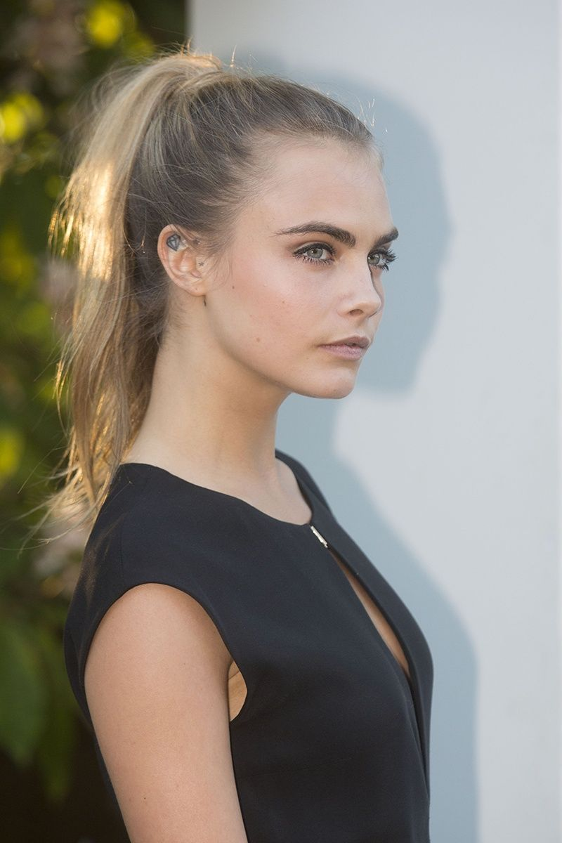 cara delevigne's sleek high ponytail is just perfect for a summer