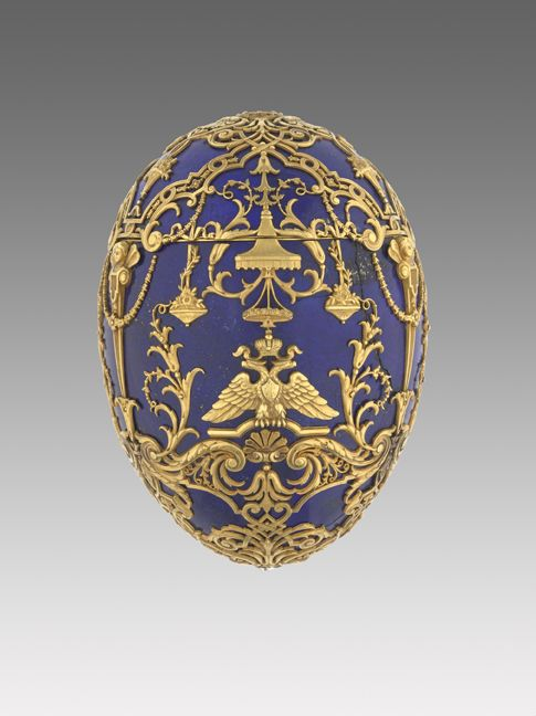 This was presented to the Empress Alexandra Fedorova in 1911, when her child, the long-awaited heir, recovered from his serious illness that was a result of his hemophilia. In the regal rococo-style, the body and the cover of the Egg is formed from six segments of the finest lapis lazuli, making 12 in total. When the Egg is opened, its surprise slowly emerges. This is an oval diamond studded frame containing the portrait of the Tsarevitch both front and back.